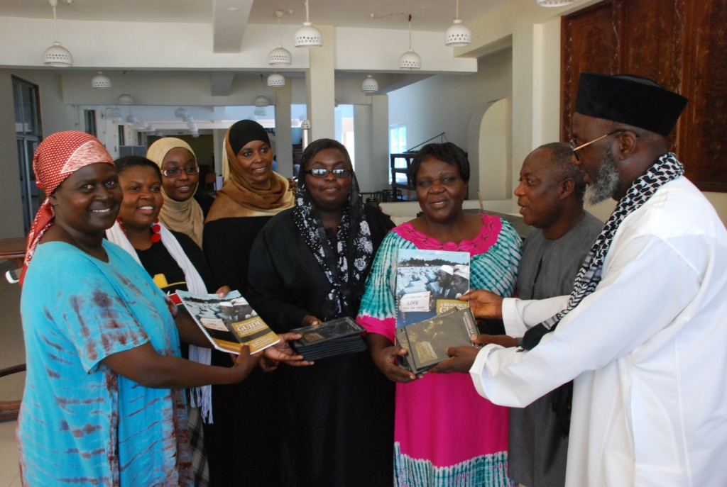 Pastor James Wuye and Imam Muhammad Ashafa present DVDs and the Resource Guide of An African Answer to the organizing teams from the Minda and Eleka Trusts. (Photo: Alan Channer)