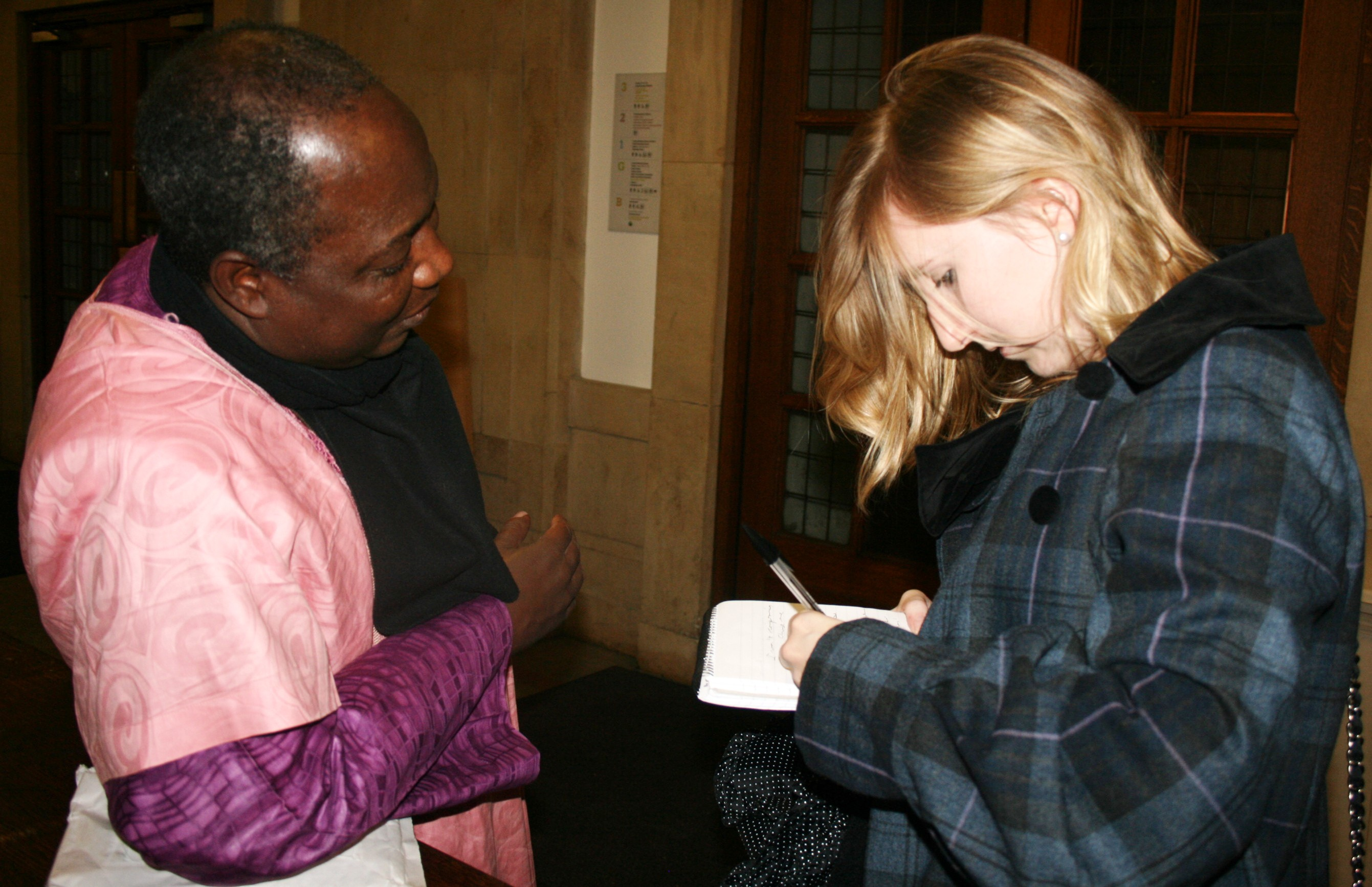 Francesca Holloway interviewing Imam Muhammad Ashafa (photo: Louise Jefferson)