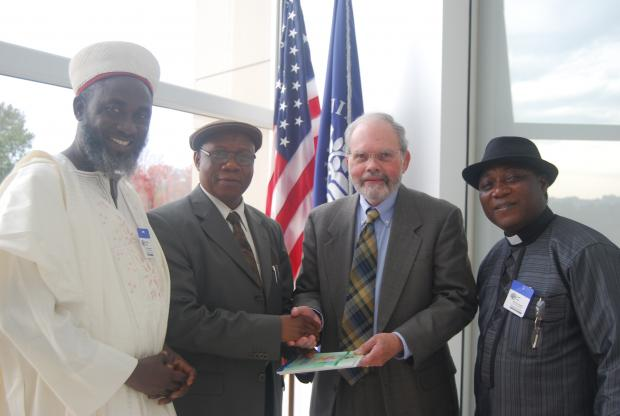 Dr David Smock, USIP receives Dr Golwa, Director General, Institute for Peace and Conflict Resolution of the Ministry of Foreign Affairs, Nigeria, and Imam Ashafa and Pastor Wuye