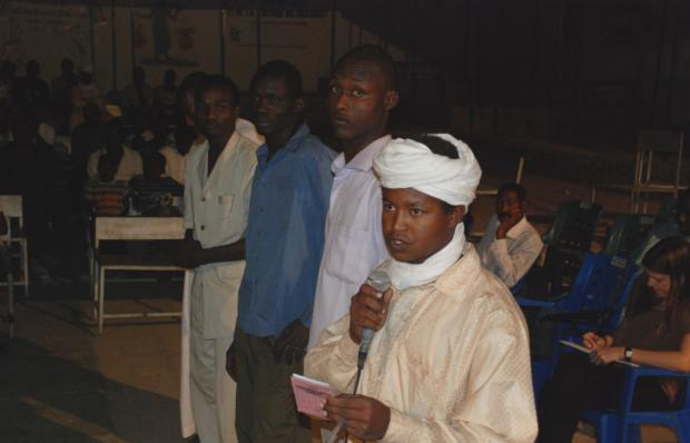 Youth line up to comment after an open-air screening of An African Answer in Abeche, eastern Chad
