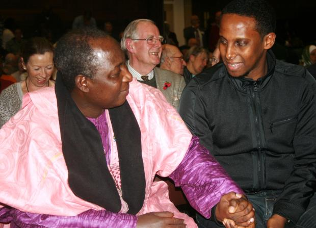 Pastor James Wuye talks with member of the audience